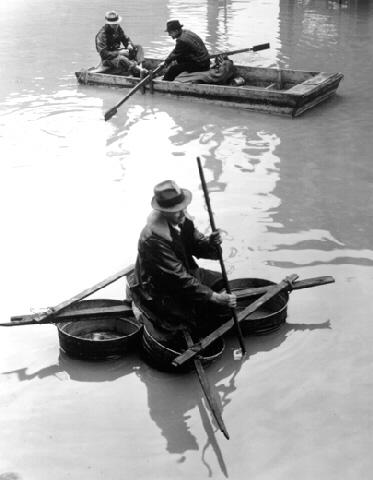 Flood Victim Paddling a Boat Made of Washtubs, Louisville, KY (?Time Inc.) Gelatin Silver print