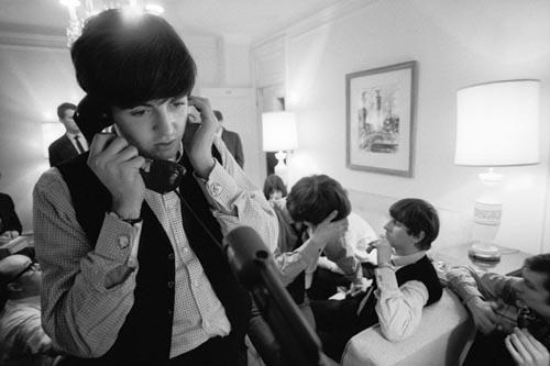 Paul McCartney on the Phone, Plaza Hotel, NYC, Feb 7, 1964. Copyright Bill Eppridge Gelatin Silver print