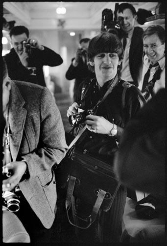 Ringo with Press Photographer's Gear. Train to D.C. Feb 10, 1964.  Copyright Bill Eppridge Gelatin Silver print