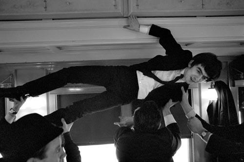 George climbs Luggage Rack. Train to D.C. Feb 10, 1964. Copyright Bill Eppridge Gelatin Silver print