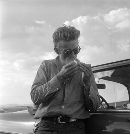 "James Dean besides his car during the filming of ""Giant""<br/>"