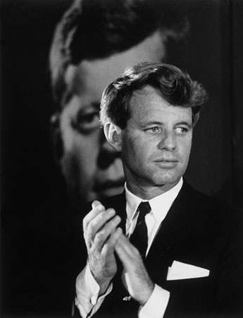 Robert F. Kennedy in front of a poster of his brother, Columbus, Ohio, 1968