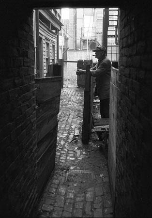Man in alley, Wilmington, DE, early 1950's Gelatin Silver print