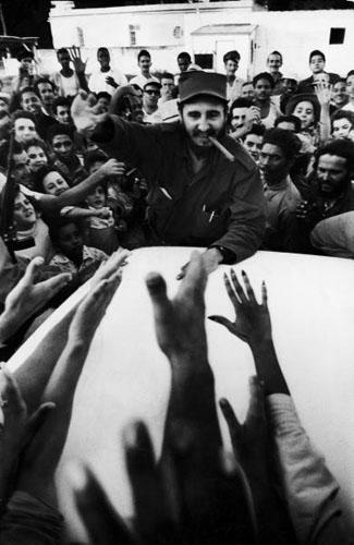 Rebel leader Fidel Castro  being cheered by a village crowd on his victorious march to Havana, 1959<br/>