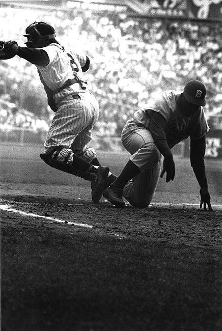 Brooklyn Dodger Jackie Robinson  steals home base against NY Yankees in the 8th inning of the 1st game of the World Series at Yankee Stadium, September 28, 1955<br/>