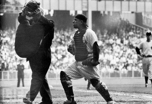 NY Yankee catcher Yogi Berra arguing with the home plate umpire who is walking away after giving the safe sign to Brooklyn Dodger Jackie Robinson's brilliant steal of home base in the 8th inning of th<br/>