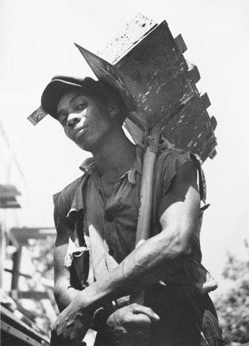 Brick carrier at model community planned by the Suburban Division of the U.S. Resettlement Administration, Greenbelt, Maryland, 1936 (for the Farm Security Administration) (Time Inc.) Gelatin Silver print