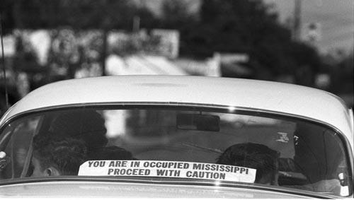 A sign in rear window of car in Philadelphia, Mississippi: Gelatin Silver print