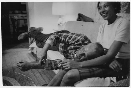 Richard and Mildred Loving laughing and watching television in their living room, King and Queen County, Virginia<br/>