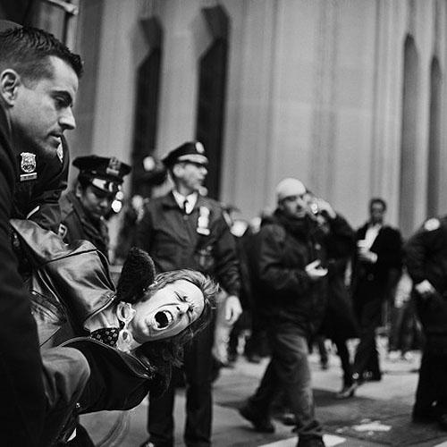 An Occupy Wall Street demonstrator is arrested on Broadway and Wall Street on November 17, 2011<br/>