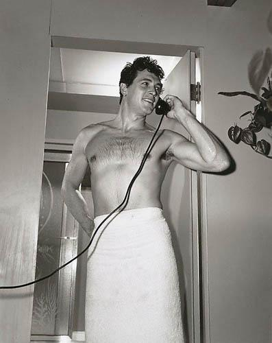 Rock Hudson on telephone at home, 1952 Gelatin Silver print