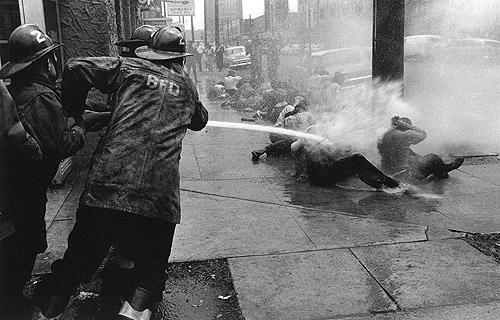 Fire hoses aimed at Demonstrators, Birmingham, Alabama, 1963<br/>