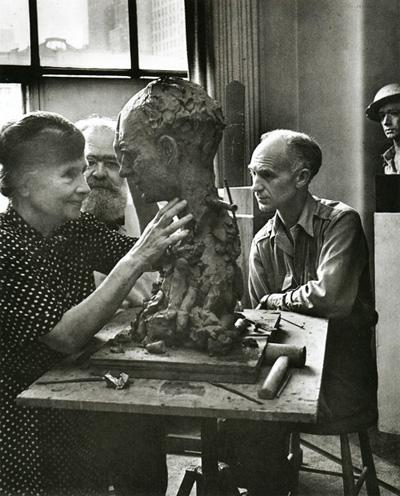 In the company of sculptor Jo Davidson and journalist Ernie Pyle, Helen Keller studies with her fingers the surfaces of Davidson's bust of Pyle, 1944 Gelatin Silver print