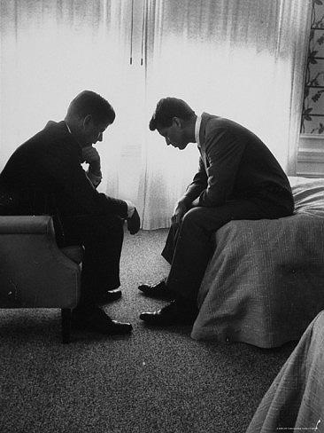 In a Los Angeles hotel suite, John F. Kennedy confers with his brother and campaign manager Bobby during the 1960 Democratic National Convention.<br/>