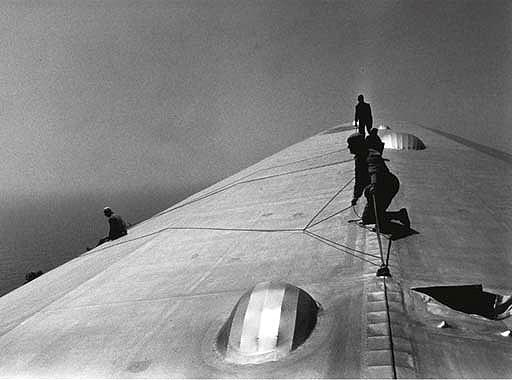 ©Time Inc. Repairing the Hull of the Graf Zeppelin during the Flight over the Atlantic, 1934 Gelatin Silver print
