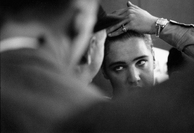 Elvis combing his hair, 1958 Gelatin Silver print
