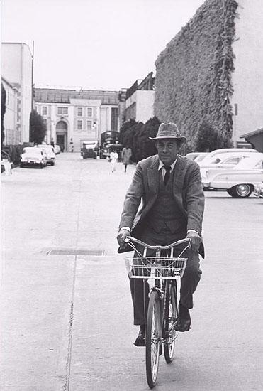 "Rex Harrison on bike going to set of ""Mt Fair Lady"", 1963 Gelatin Silver print"