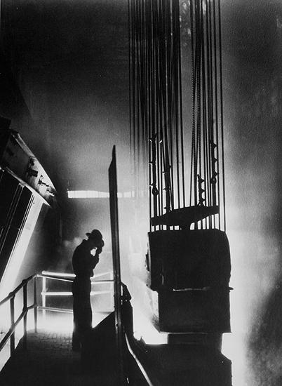 Ford Motor Company foreman shields his eyes against fiery light of open hearth mill, Detroit, MI 1929 Gelatin Silver print