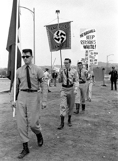 Members of the American Nazi Party marching against desegregating the Washington Redskins, District of Columbia Stadium, Washington, DC, 1961<br/>