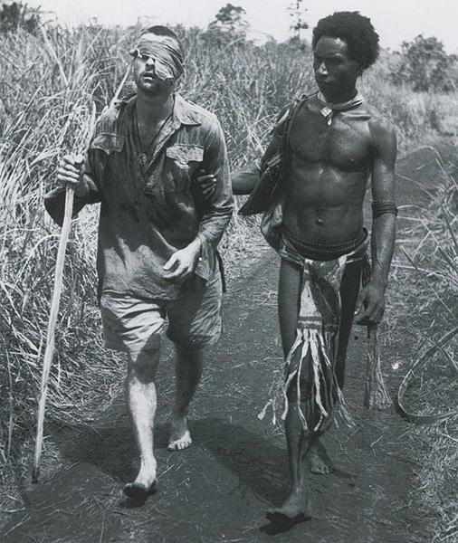 Blinded soldier, New Guinea (George Whittington being led to an aid station by Raphael Oimbari) 1942<br/>