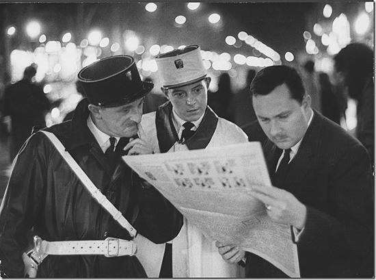Ralph Crane - Frenchman reading newspaper reports of assassination of President John F. Kennedy, 1963 Vintage Gelatin Silver Print
