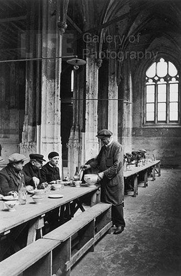 Destitute men being fed in the Notre Dame Cathedral, Rouen, France, 1931 Gelatin Silver print