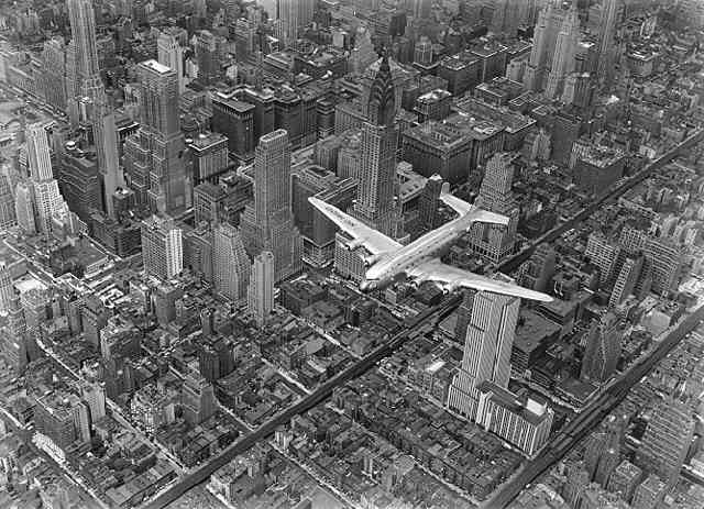 A DC4 Flying Over New York City (?Time Inc.)