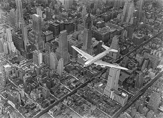 A DC4 Flying Over New York City (?Time Inc.) Gelatin Silver print