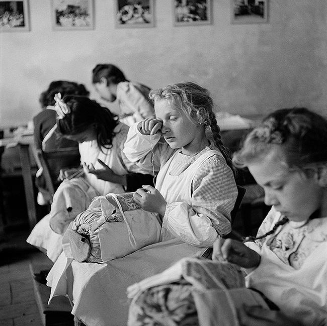 """Tired Eyes"". Orphans in a sewing class, Trieste, Italy, 1947<br/>"