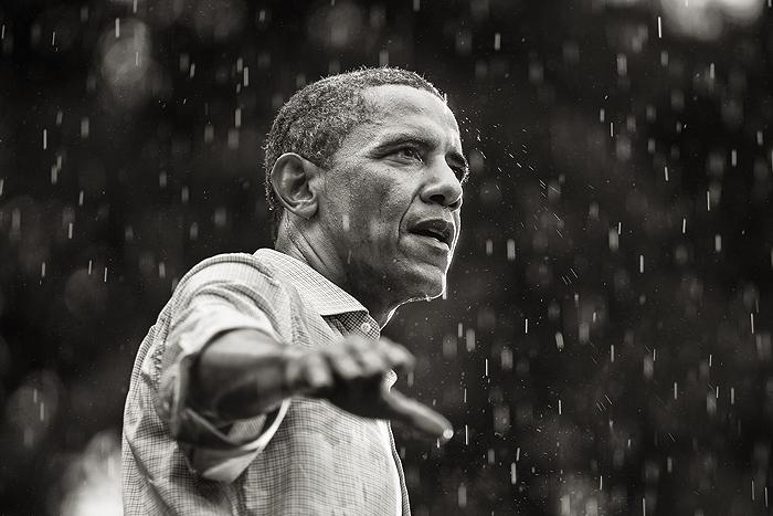 U.S. President Barack Obama speaks in the rain during a campaign rally in Glen Allen, Virginia, 2012<br/>