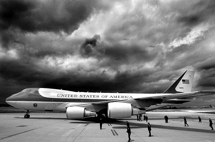 Storm clouds loom overhead as Air Force One and U.S. President George W. Bush arrive in Paris Archival Pigment Print