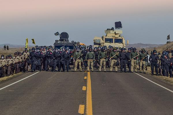 Police line during the sweep of Treaty Camp, north of the Standing Rock Sioux Reservation, October 27, 2016 Archival Pigment Print