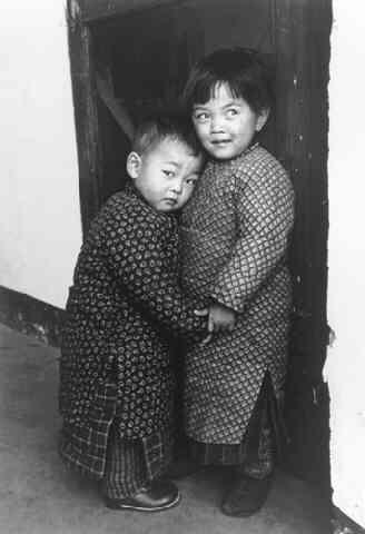 A Child Protects Her Brother from a Stranger with a Camera, Tsingtao, China (Time Inc.) Gelatin Silver print