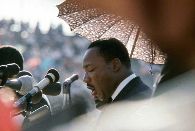 "Martin Luther King speaking speaking at Soldier Field in Chicago during a large ""freedom rally"" which focused on housing discrimination, 1966<br/>"