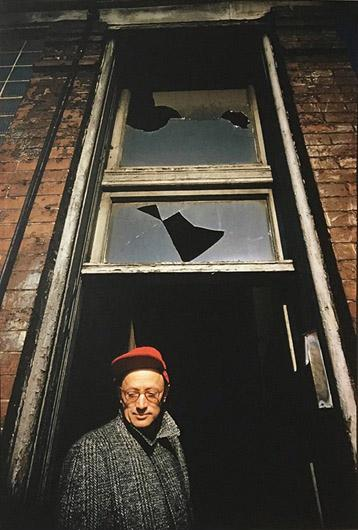 Nelson Algren at his Chicago home site as it is being wrecked for a new expressway, 1957<br/>