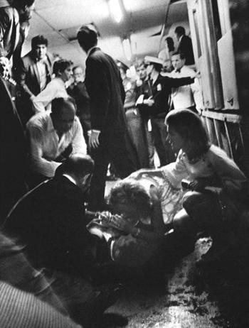 Ethel speaking to her husband Robert as Jean Kennedy Smith kneels nearby, Ambassador Hotel kitchen, June 5, 1968 Vintage Gelatin Silver Print