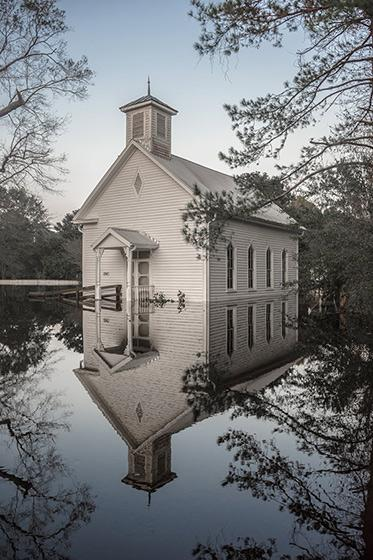 A church flooded by Hurricane Florence stands silently in its reflection in Burgaw, North Carolina, 2018 Archival Pigment Print