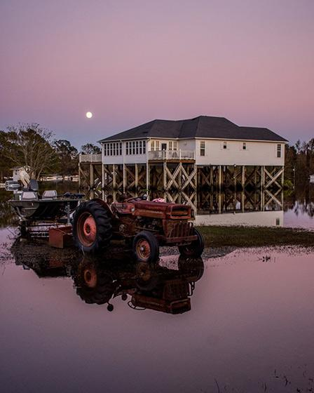 A home on narrowly escapes the flood as the sun sets in Rocky Point, 2018 Archival Pigment Print