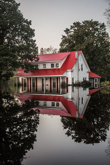 A local pastor's home, which succumbed to flood waters in Burgaw, North Carolina. Archival Pigment Print