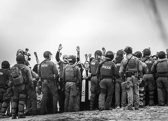 Religious leaders being arrested for peacefully protesting the immigration policies of the Trump administration, on the border near San Diego, California, December 10, 2018<br/>