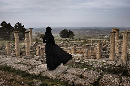 Shehat, Libya March 25, 2012 A Libyan woman visits the ruins of the ancient city of Cyrene in eastern Libya's Green Mountains<br/>