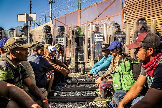 Asylum seekers from the Central American exodus being prevented from making claims by Mexican Federal Police, Tijuana, Mexico, November 25, 2018<br/>