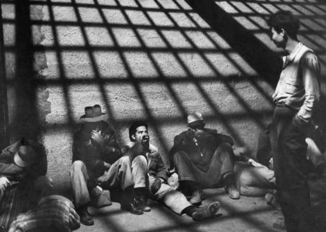 "A group of illegal Mexican immigrants sprawled on floor of border patrol jail cell await deportation back to their homeland during ""Operation Wetback"", 1955<br/>"