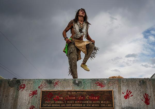 Than Tsídéh, 19, of the Ohkay Owingeh Pueblo dances on the empty platform where a statue of Juan de Oñate was removed,  Rio Arriba county, New Mexico, June, 2020<br/>