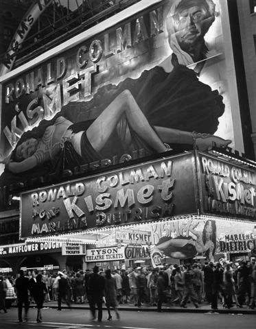 Huge billboard depicting Marlene Dietrich in Kismet over Astor Movie theater in Times Square, New York, 1944<br/>