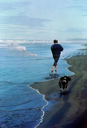 Presidential candidate Bobby Kennedy and his dog, Freckles, running on an Oregon beach, 1968 (cover of Life Magazine, June 14, 1968) Archival Pigment Print