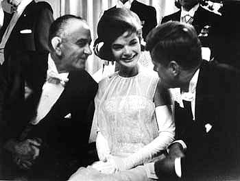 President John F.Kennedy with his wife, Jacqueline, and Vice-President Lyndon B. Johnson at inaugural celebration, Mayflower Hotel, Washington, DC, 1961 Gelatin Silver print