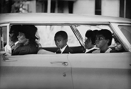 The Chaney family as they depart for the burial of James Chaney, Meridian, Mississippi, August 7, 1964 Gelatin Silver print