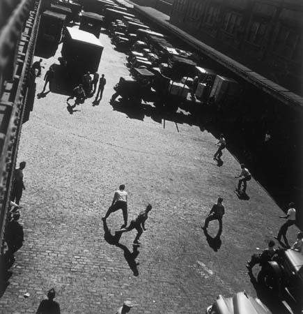 Playing Ball Outside Entrances To Hudson River, New York, 1949 Gelatin Silver print