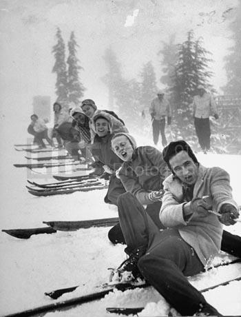 Playing tug-of-war during snowstorm at Timberline Lodge Ski Club party,1942 by Ralph Morse Gelatin Silver print